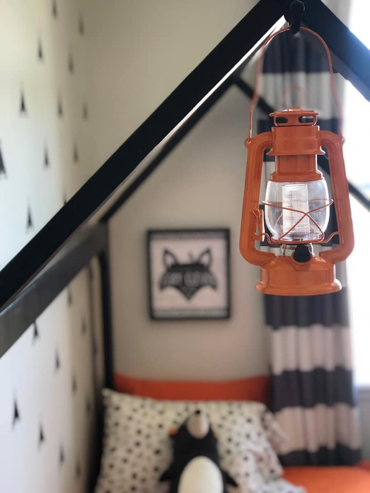 young boy bedroom with orange and black